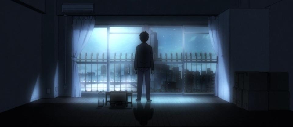 Rei face au fleuve dans son appartement