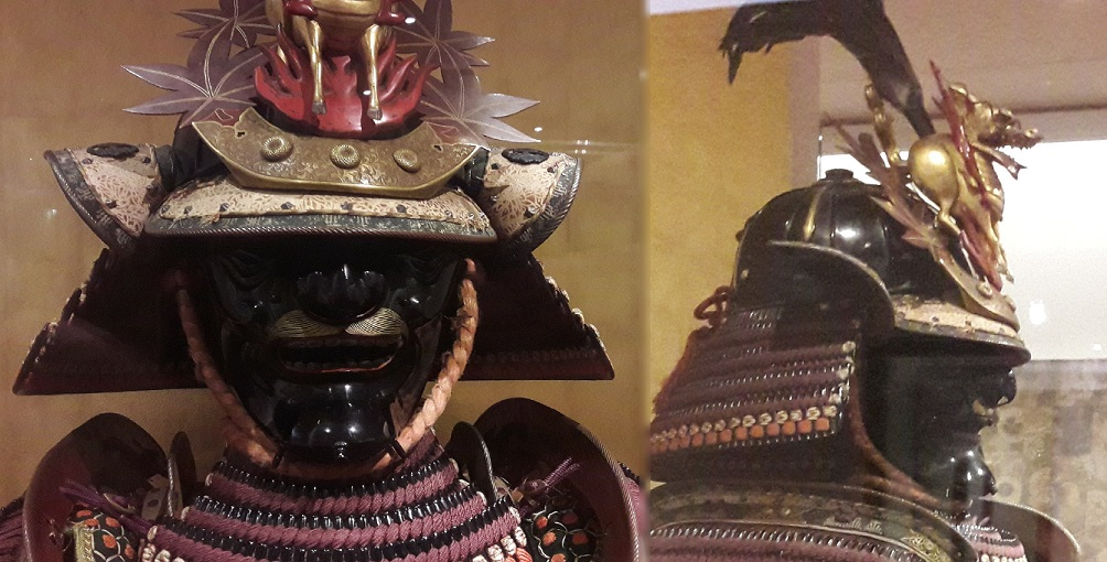 Le masque effrayant d'un samurai, dont le casque est orné du daim ailé Kirin